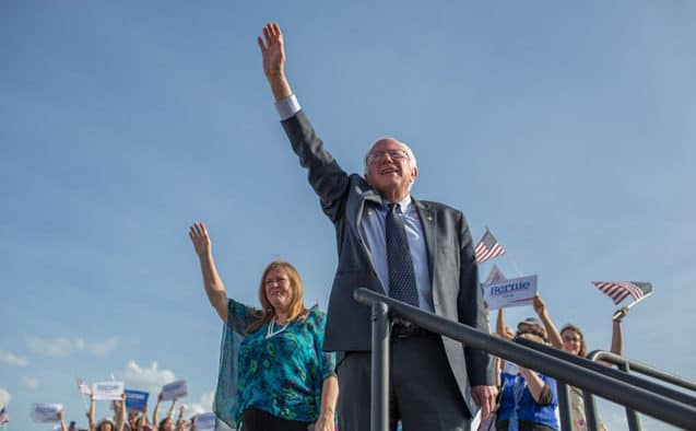 Bernie with raised hand