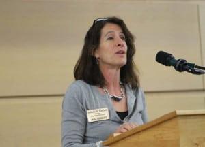 Jolinda LaClair speaking at a podium