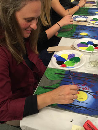 Photo courtesy SVM Participants in a past Sip and Paint at Slate Valley Museum create a moonlit night scene on slate.