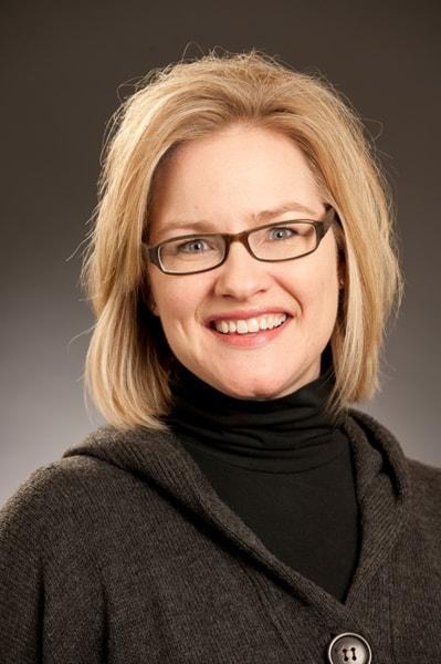 Portrait of Dr. Jennifer L. Scott in front of a grey background