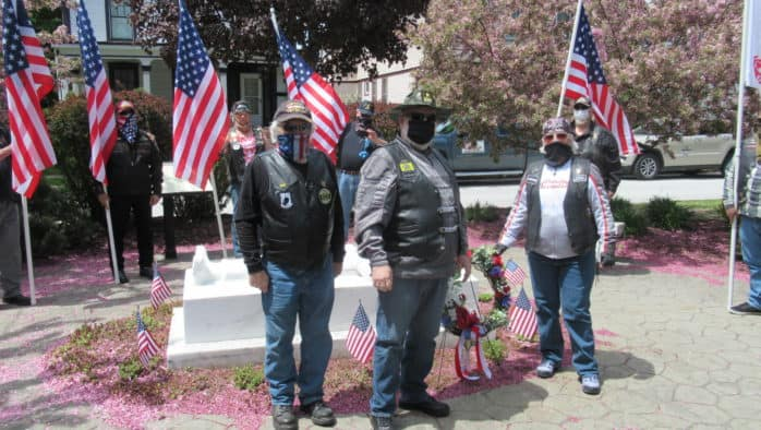 Patriot Guard Riders, a motorcycle troop, place wreath honoring vets.