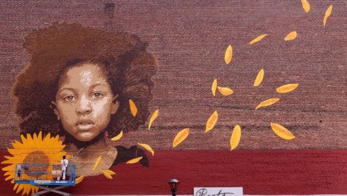 Artist paints new mural in downtown Rutland to amplify Black Lives Matter Movement